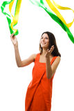 Woman in vivid color dress play with flying ribbon Stock Photos