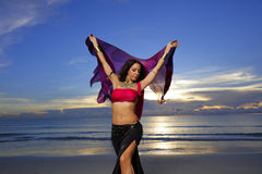 Woman with vivid colors on the beach Stock Images
