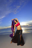 Woman with vivid colors on the beach Stock Photos