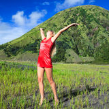 Woman and volcano Stock Image