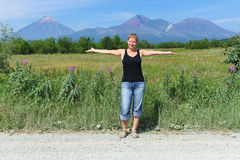 Woman and Volcano Stock Photography
