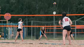 Woman volleyball serve. Woman getting ready to to serve the volleyball while standing on the beach slow motion. stock video footage