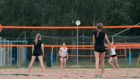 Woman volleyball serve. Woman getting ready to to serve the volleyball while standing on the beach slow motion. stock video