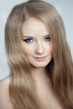 Woman with a volumetric hair Royalty Free Stock Image