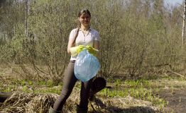 Woman volunteer holding garbage bag. In the forest. Eco friendly concept royalty free stock photos