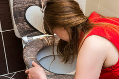 Woman vomiting in the bathroom Royalty Free Stock Image