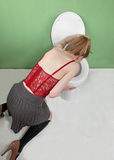 Woman vomiting Royalty Free Stock Image