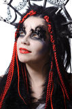 Woman with voodoo shaman make-up. Portrait of woman with voodoo shaman make-up  on white Stock Photography