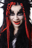 Woman with voodoo shaman make-up. Portrait of woman with voodoo shaman make-up  on white Stock Images