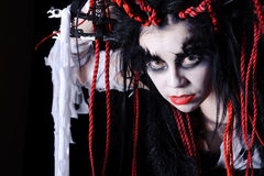 Woman with voodoo shaman make-up. On black Royalty Free Stock Photography