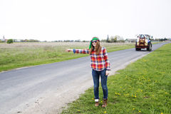 Woman vote on countryside road near field Royalty Free Stock Photos