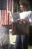 Woman voter reading election pamphlet Stock Photo