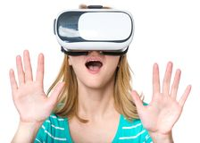 Woman with VR glasses. Amazed woman wearing virtual reality goggles watching movies or playing video games, isolated on white background. Surprised girl looking Royalty Free Stock Image