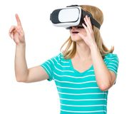 Woman with VR glasses. Amazed woman wearing virtual reality goggles watching movies or playing video games, isolated on white background. Surprised girl looking Royalty Free Stock Photo