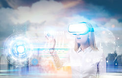 Woman in vr glasses and graphs, city Stock Photo