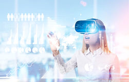 Woman in vr glasses and graphs Stock Image