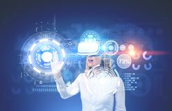 Woman in VR glasses, HUD and graphs Stock Photos