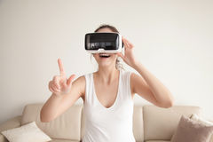 Woman in VR glasses makes purchases in online shop Royalty Free Stock Images