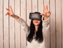 Woman in VR glasses. Woman in virtual reality helmet. VR glasses Royalty Free Stock Photo