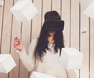 Woman in VR glasses. Woman in virtual reality helmet. VR glasses Royalty Free Stock Photography