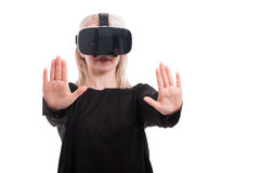 Woman with vr goggles touching invisible screen Stock Photos