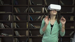 Woman in vr head-mounted display stock footage