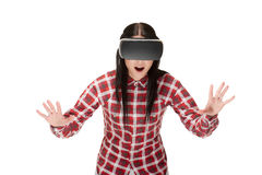 Woman in VR headset catching and playing. Royalty Free Stock Photography