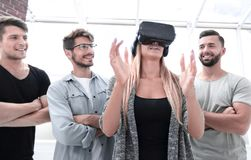 Progressive girl smiling while wearing virtual reality glasses stock photography