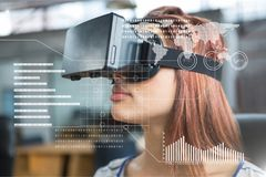 Woman in VR headset standing behind interface Royalty Free Stock Images