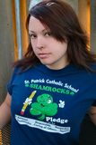 Woman w/elementary school shirt. Woman in a chair with an elementary school shirt on, posed Royalty Free Stock Images