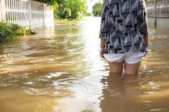 Free Woman Wade Flooding In Her House. Closeup On Her Leg. View Behin Stock Photo - 102344020