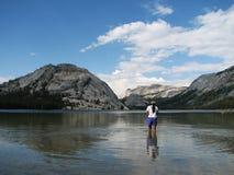 Woman wades in Tenaya lake Royalty Free Stock Photography