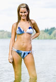Woman wading in lake Royalty Free Stock Images
