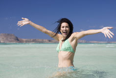A woman wading in the sea Stock Image