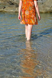Woman wading through sea water Royalty Free Stock Photography