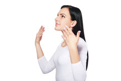 Woman wafting air to nostrils. Closeup portrait of attractive woman wafting air to nostrils to smell better,  on white background Royalty Free Stock Photos