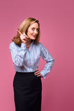 Woman wagging finger. Woman wearing striped button down shirt, wagging finger on pink background Stock Images