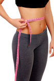 Woman waist with measuring tape Royalty Free Stock Photo