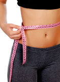 Woman waist with measuring tape Royalty Free Stock Photography