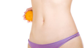 Woman waist with orange Stock Photos