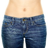 Woman waist wearing jeans. Weight loss stomach. Woman waist wearing jeans. Weight loss stomach closeup. Skinny jeans on a healthy slim fit body Royalty Free Stock Images