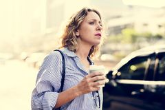 Woman on the wait for cab Stock Image
