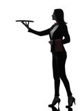 Woman waiter butler holding empty tray  silhouette. One  woman waiter butler holding empty tray in silhouette on white background Royalty Free Stock Images