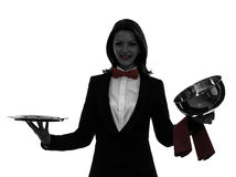 Woman waiter butler opening catering dome silhouette. One  woman waiter butler opening catering dome in silhouette on white background Royalty Free Stock Photography