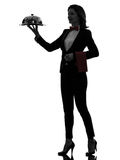 Woman waiter butler serving dinner silhouette Royalty Free Stock Photos