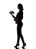 Woman waiter butler serving dinner silhouette. One  woman waiter butler serving dinner with catering dome in silhouette on white background Royalty Free Stock Images
