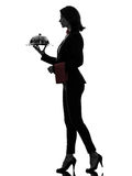 Woman waiter butler serving dinner silhouette. One caucasian woman waiter butler holding empty tray  in silhouette  on white background Stock Photography