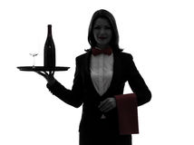 Woman waiter butler  serving red wine silhouette. One caucasian woman waiter butler serving red wine in silhouette  on white background Stock Images