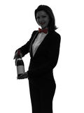 Woman waiter butler  serving red wine silhouette. One caucasian woman waiter butler serving red wine in silhouette  on white background Stock Photography