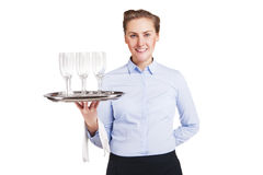 Woman in waiter uniform holding tray with glasses, smiling. Royalty Free Stock Image